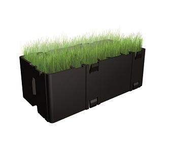 Greenbrick is een holle kunststof steen waarin gras voldoende ruimte krijgt om te groeien.