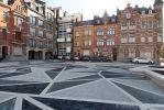 Renovatie stadsplein met verschillende patronen in straatwerk