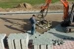 Machinaal pakket op zandbed