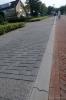 Parkeervakken op trottoir met overrijdbare band