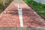 Waarschuwingsmarkering paal op fietspad