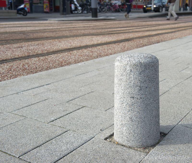 Gewassen sierpaal in de kleur grijs antiparkeerelement beton