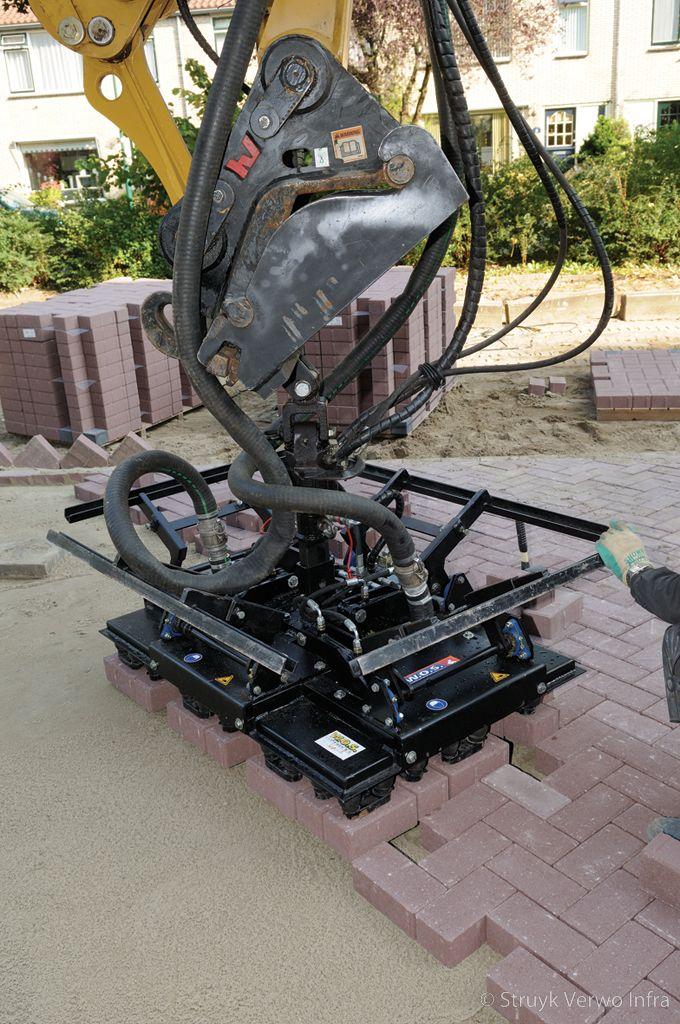 Mechanisch verwerken betonstraatstenen met vacuum klem
