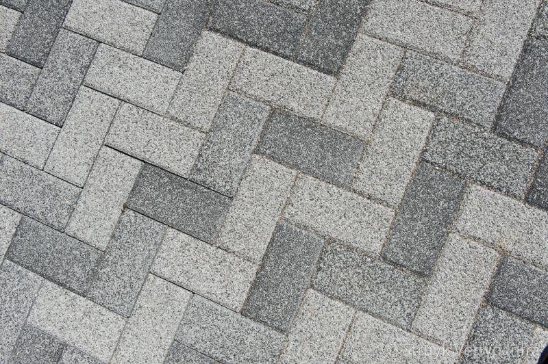 Mix van grijstinten in bestrating de schans ridderkerk